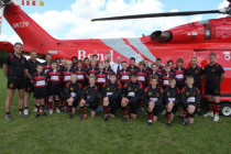 Bond backs young rugby stars with fly-in helicopter visit
